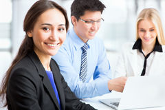 Business woman and her collegues. Business women and her collegues working together in an office Stock Photo