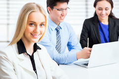 Business woman and her collegues. Business women and her collegues working together in an office Stock Images