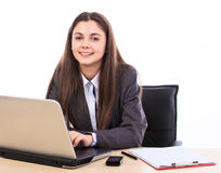 Business Woman at her desk. Beautiful business woman at her desk isolated on white background Stock Photo