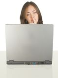 Business woman on her desk with a laptop Royalty Free Stock Image