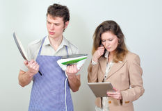 Business woman and her husband Stock Images