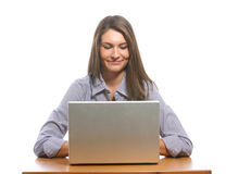 A business woman on her laptop at a desk Royalty Free Stock Photo