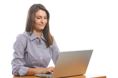 A business woman on her laptop at a desk Royalty Free Stock Photography