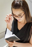 Business woman with her notebook planner Royalty Free Stock Photography