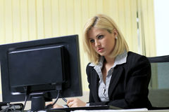 Business woman in her office. Business woman in the office working with the computer Royalty Free Stock Photography