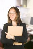Business woman in her office holding a folder Stock Photography