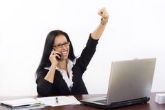 Business woman at her office on phone. Winning something talking on the phone Stock Photo