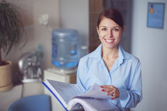 Business woman in her office Stock Image