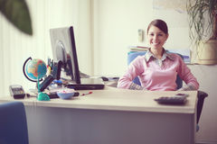 Business woman in her office Royalty Free Stock Image