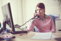 Business woman in her office Stock Images