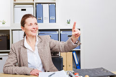 Business woman in her office using Royalty Free Stock Photography