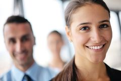 Business woman with her staff in background at office Royalty Free Stock Images