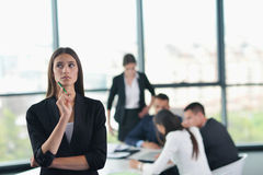 Business woman with her staff in background at office Stock Image