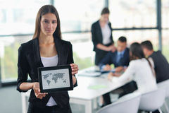 Business woman with her staff in background at office Stock Photography
