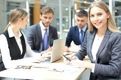 Business woman with her staff, people group in background at modern bright office indoors. Business woman with her staff, people group in background at modern royalty free stock photography