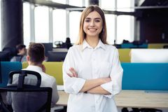 Business woman with her staff, people group in background at modern bright office indoors. royalty free stock photo