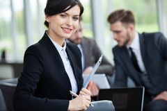 Business woman with her staff, people group in background at modern bright office indoors royalty free stock photos