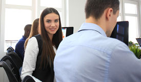 Business woman with her staff, people group in background at modern bright office. Royalty Free Stock Photography