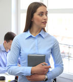 Business woman with her staff, people group in background at modern bright office. Stock Photo