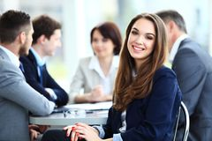 Business woman with her staff, people group in background. Business women with her staff, people group in background at modern bright office indoors stock photography