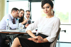 Business woman with her staff, people group in background Stock Image