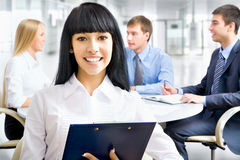Business woman with her staff Stock Photos