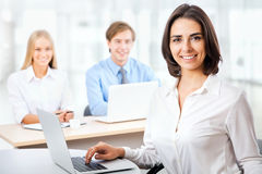 Business woman with her staff Royalty Free Stock Photos