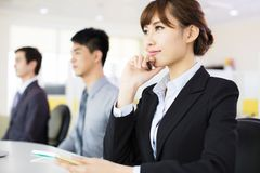 Business woman with her staff Stock Photography