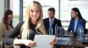 Business woman with her staff Royalty Free Stock Image