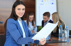 Business woman with her staff Royalty Free Stock Images