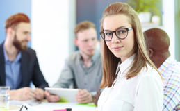 Business woman with her staff Stock Images