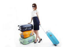 Business woman with her suitcases Stock Images