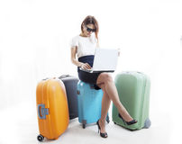 Business woman with her suitcases Stock Photo