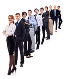 Business woman and her team. Isolated over a white background Royalty Free Stock Image