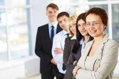 Business woman with her team. Beautiful business woman and her business team Royalty Free Stock Photos