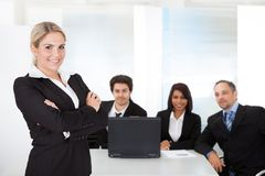 Business woman and her team. Portrait successful business women and her team Stock Photos