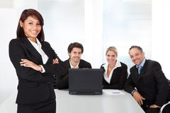 Business woman and her team. Portrait successful business women and her team Royalty Free Stock Image