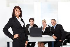 Business woman and her team. Portrait successful business women and her team Stock Photo