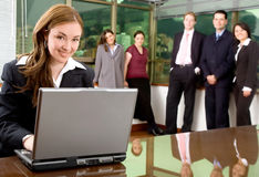 Business woman and her team Stock Images