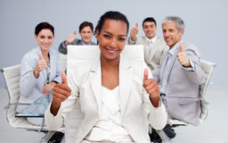 Business woman and her team with thumbs up. Afro-American businesswoman and her team with thumbs up in the office Stock Photography