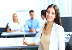 Business woman with her team. Business women with her team at the office Royalty Free Stock Image