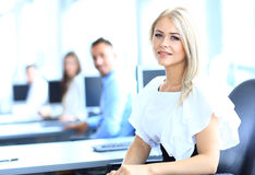 Business woman with her team. Business women with her team at the office Royalty Free Stock Images