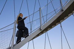 Business woman on her way to the top. Stock Image