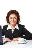 A business woman at her workplace. Portrait of a elegant business woman at her workplace Stock Photos