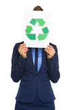 Business woman hiding behind recycle sign Stock Photography