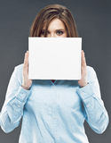 Business woman hiding face behind banner. Business woman hiding face behind white banner Stock Photo