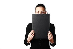 Business woman hiding face behind black folder Stock Photo