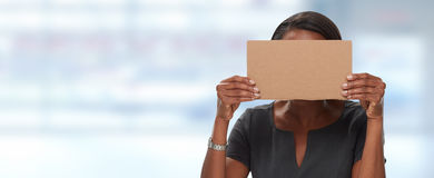 Business woman hiding face with cardboard. Royalty Free Stock Image