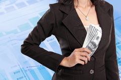 Business woman hiding money inside her jacket. Pocket on virtual financial background Royalty Free Stock Image