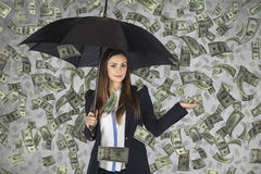 Business woman hiding under an umbrella, falling money,. Businesswoman hiding under an umbrella, falling money Stock Photography